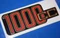 Aufkleber 1000cc R100 f.Batterieabdeckung gold/rot